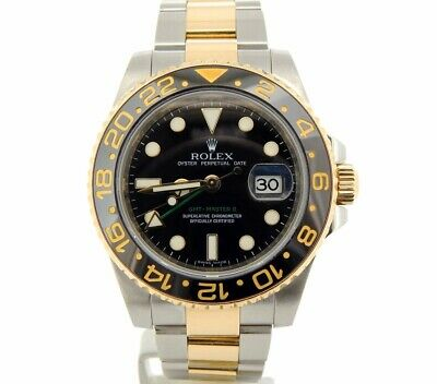 $ CDN15084.90 • Buy Rolex GMT-Master II Stainless Steel 18K Yellow Gold Watch Black Ceramic 116713