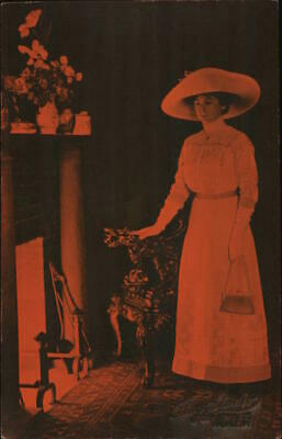 £7.25 • Buy Women RPPC A Woman In A Large Hat Standing Next To A Fireplace Postcard Vintage