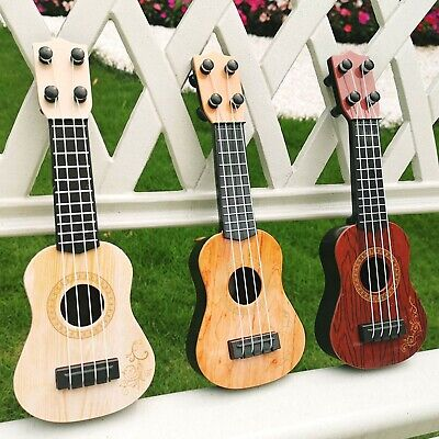 AU12.94 • Buy Children's Toy Gift Ukulele Guitar Musical Instrument Suitable For Baby Kids AUS