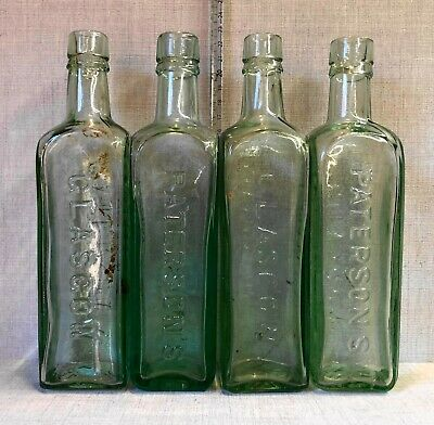 Four Large Old Paterson's Glasgow Aqua Glass Coffee Bottles. • 5£