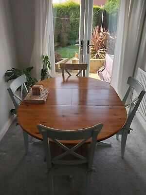Round Extendable Dining Table And 4 Chairs • 35£
