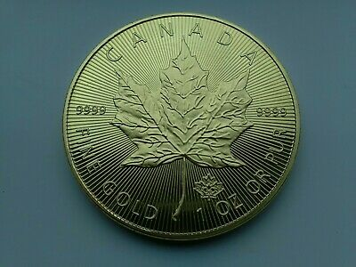 £7 • Buy 2021 Canadian Maple Leaf 50dollar Coin(RESTRIKE) GOLD IN COLOUR IN BUNC CONDITIN