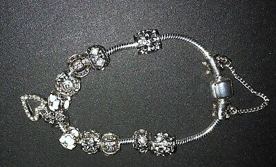 Ladies Silver Coloured Charm Braclet. • 1.20£