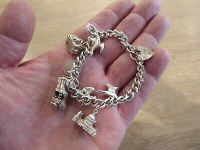 Beautiful Vintage Solid Silver Charm Bracelet With 8 Charms • 78£