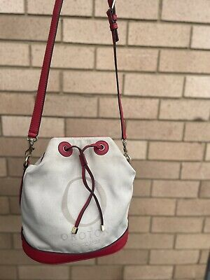 AU35 • Buy Oroton Canvas Leather Trims Drawstring Top Bucket Style Cross Body Bag Red/cream