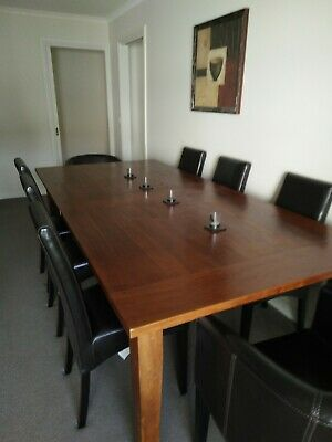 AU1200 • Buy Dining Table, Solid Wood With 8 Dark Brown Leather Chairs.