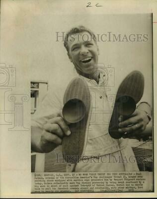 1970 Press Photo Yachtsman Paul Salmon Displays Special Shoes Presented To Him. • 11.23£