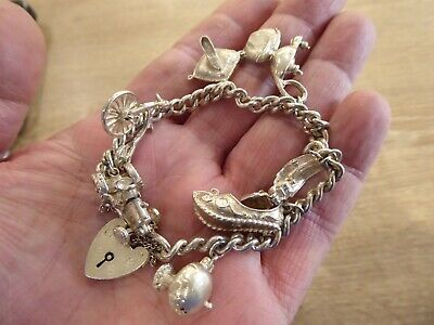 Beautiful Vintage Solid Silver Charm Bracelet With 8 Charms • 85£