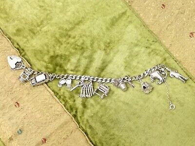 Sterling Silver Vintage Charm Bracelet With 10 Charms - 35g • 10.50£