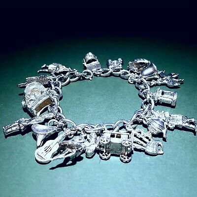 Vintage Sterling Silver Charm Bracelet. 19 Charms. Weight 58g. Some Rare Charms. • 35£