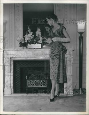 £14.15 • Buy 1950 Press Photo A Woman Dresses In Fall Dotted Silk Dress Next To Fireplace.