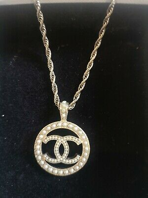 £350 • Buy Chanel  Classic Gold And Pearl Detail Classic CC Logo Pendant Necklace, Pre Worn