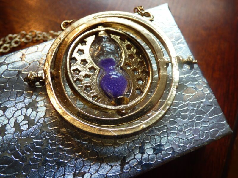 $7.99 • Buy US Seller - NEW Harry Potter Time Turner PURPLE SAND Rotating Necklace F/S